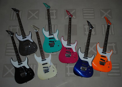 Seven Charvel Spectrum Guitars